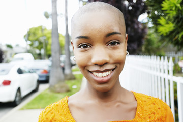 Portrait of bald smiling Black woman