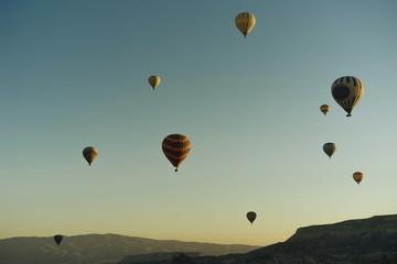 Hot air balloons flying at sunset