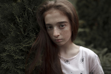 Portrait of serious Caucasian girl with freckles