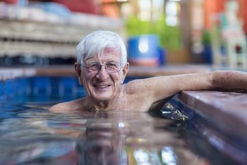 Portrait of smiling Caucasian man in swimming pool