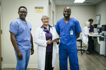 Portrait of smiling doctor and nurses