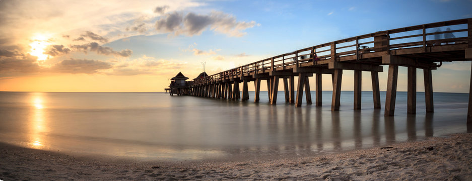 Naples Pier on the beach at sunset