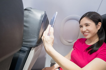woman selfie in the airplane