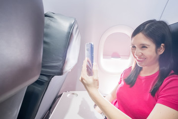 woman selfie in the airplane