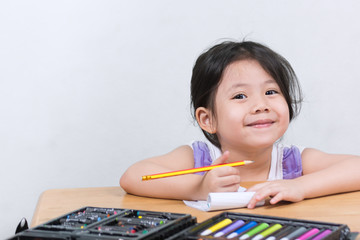 Cute Little Asian Girls enjoy drawing art.