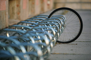 Locked Tire of a stolen Bike left in a Bicycle Stand