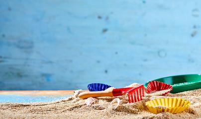 Colorful kids toys on a sandy beach
