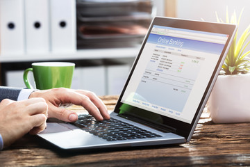 Businessperson Doing Online Banking On Laptop