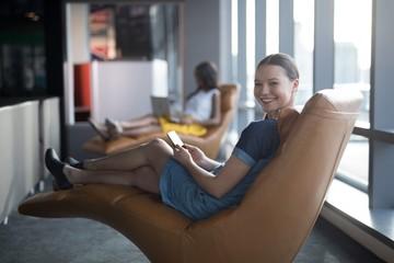 Portrait of female executive using digital tablet