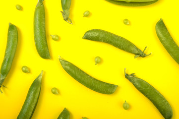 Peas on a yellow background