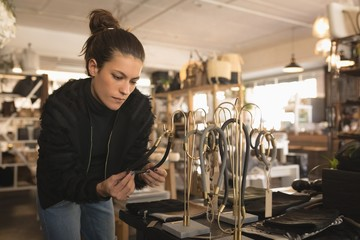 Woman selecting accessories in boutique shop