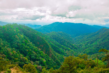 Photo landscape. forest  mountain Clouds and sky . Mountain in national park Thailand.