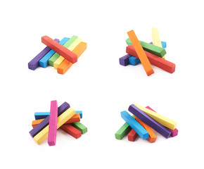 Pile of rainbow colored chalks isolated