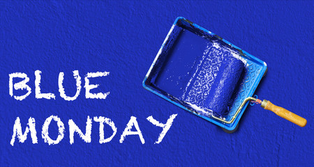 Painting tools and text on blue Monday wall