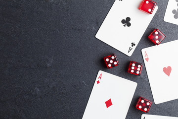 Ace playing cards with red dice. Casino betting and gambling concept Wall mural