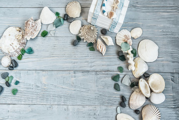 Sea, beach saver, background.  the mood of rest, vacation. Shells of stone pebbles and a white chest on a gentle light blue vintage, gray, old, wooden background.
