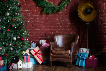 Image of room with Christmas decorations, spruce with decorations, leather armchair