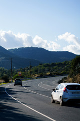 Photo of road with car in mountains