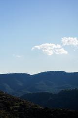 Image against sun of mountain landscape