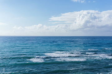 Image of blue sea and cloudy sky
