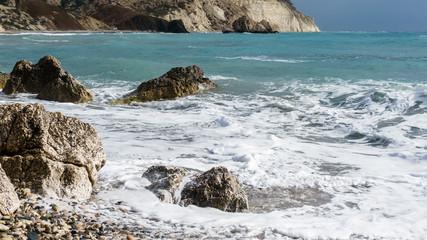 Images of foamy sea, stones