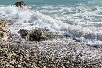 Picture of foamy sea, pebble beach, stones