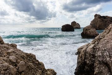 Photo of sea, rocks, gloomy cloudy sky