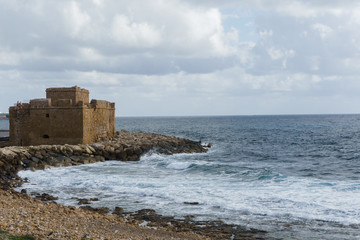Photo of brick building on seashore