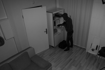 Robber Searching House For Valuables