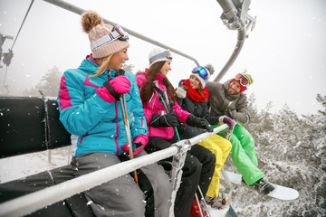 friends skiers enjoying in the slopes at winter vacations