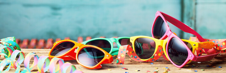 Colorful sunglasses and party streamers