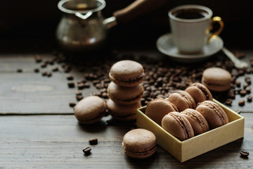 French biscuits macarons with coffee