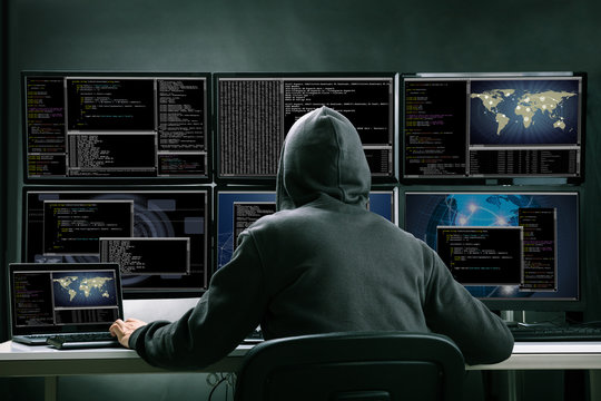 Hacker Using Multiple Computers For Stealing Data