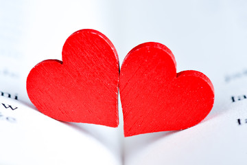 Red hearts on book. Happy Valentine's day red hearts on  book.