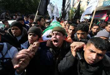 Mourners carry the body of a 16-year-old Palestinian during his funeral in centre Gaza Strip