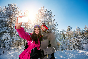 couple making selfie and having fun on the snow