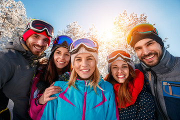 portrait of friends skiers on winter holidays