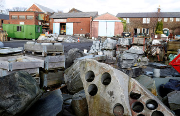 Granite in its various stages lie in the yard outside Kays Factory in Mauchline, Scotland