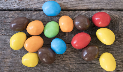 colorful round candy on a wooden table. Top view.