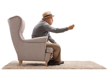 Angry senior sitting in an armchair and arguing