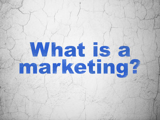 Marketing concept: Blue What is a Marketing? on textured concrete wall background