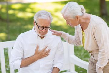 senior man feeling sick at summer park
