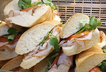 sandwiches with ham rocket and fresh tomato