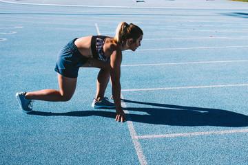 Athlete sprints on running track