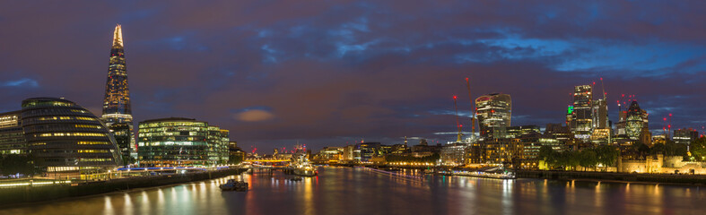 London - The panorama with the skyscrapers from the Tower bridge at dusk.