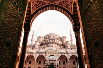 Beautiful Sultanahmed Blue Mosque through the gate, Istanbul, Turkey