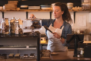 Beautiful waitress working at counter