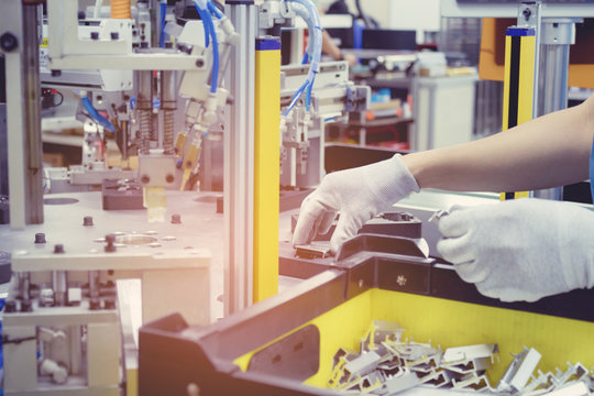 Automatic part assembly machine. Auto robot machine used electrics and air pressure.