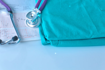 Stethoscope on a table with medical uniform