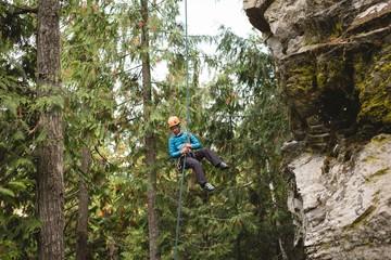 Rock climber climbing the rocky cliff